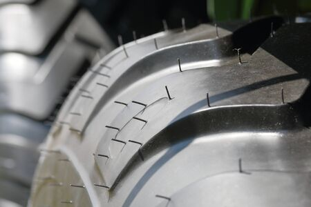 Agricultural vehicle tire wheel. Visible protector. Close-up.