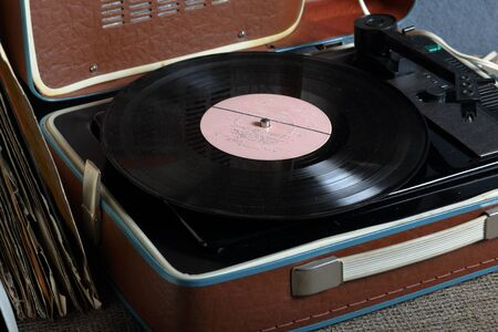 An old gramophone with a vinyl record mounted on it.