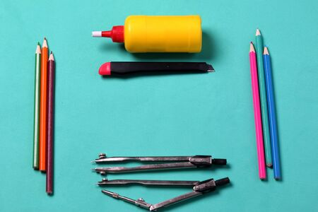 Accessories for drawing, drafting and application. Laid out on a mint background. School supplies.
