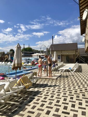 UKRAINE, SOLOTVINO, SEPTEMBER 3, 2019, Infrastructure of the resort Salt Crystal. Living rooms, sun loungers and pool. Visitors are standing in the shower, washing off salt water.
