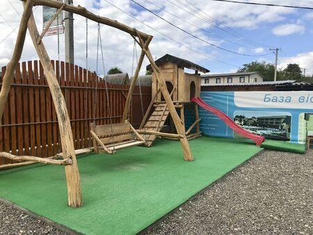 UKRAINE, SOLOTVINO, SEPTEMBER 3, 2019, Infrastructure of the resort Salt Crystal. Childrens corner, swing. Redakční