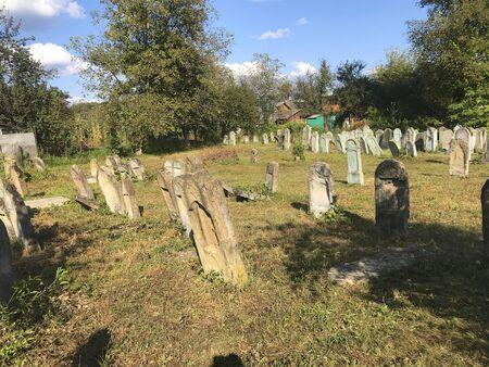 UKRAINE, TERESVA, SEPTEMBER 3, 2019, Old Jewish cemetery. The territory is well-groomed. Old tombstones bent over. Redakční