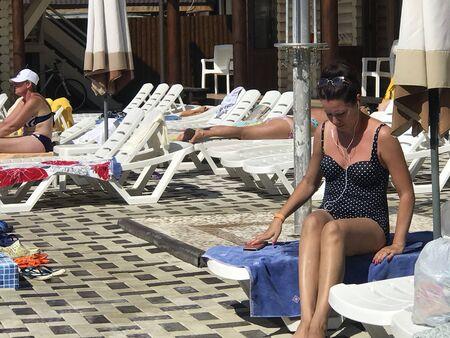 UKRAINE, SOLOTVINO, SEPTEMBER 3, 2019, Infrastructure of the resort Salt Crystal. Living rooms, sun loungers and pool. Visitors relax on the sun loungers. Redakční