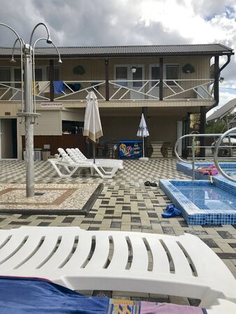 UKRAINE, SOLOTVINO, SEPTEMBER 3, 2019, Infrastructure of the resort Salt Crystal. Living rooms, sun loungers and pool.