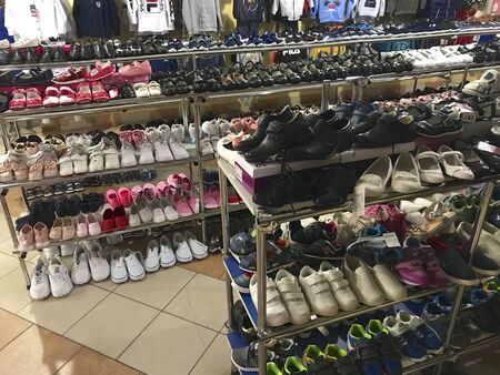 UKRAINE, TRANSCARPATHIA, SEPTEMBER 3, 2019, shoes on the shelves in the store. Different types, sizes and colors