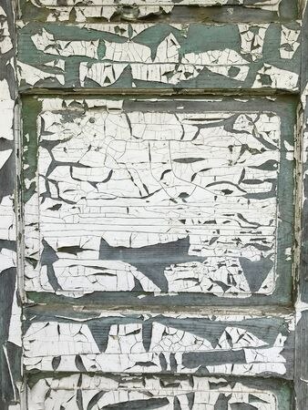 Background from a wooden board covered with peeling paint from time to time. Numerous cracks and exfoliation are visible. Stock fotó