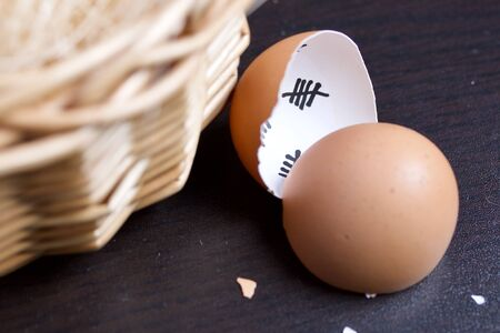 Chopped eggshell. It marks the days past. Next to the egg basket. Chicken hatching.