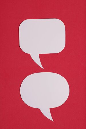 Speech bubbles of different sizes and shapes. Against the background of coral color.