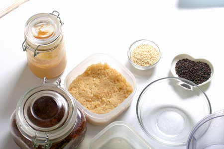 Dried fruit and nut sweets. The ingredients and tools for cooking are spread out on the table. Cooking sweets at home in isolation during an epidemic.