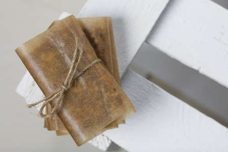 Nut & Dried Fruit Energy Bars. Wrapped in paper and tied with twine. Close-up shot.