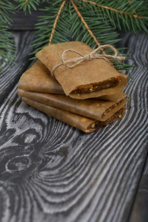 Homemade Nut & Dried Fruit Energy Bars. Wrapped in paper and tied with twine.