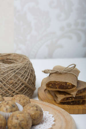 Dried fruit and oatmeal sweets. Homemade Nut & Dried Fruit Energy Bars. Wrapped in paper and tied with twine.