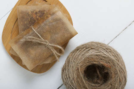 Nut & Dried Fruit Energy Bars. Wrapped in paper and tied with twine. Nearby a skein of twine. Shot from above