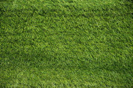 Green Artificial Grass on a Football Field Background photo