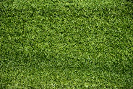 Green Artificial Grass on a Football Field Background
