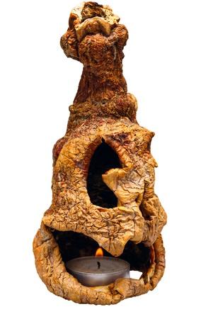 vexation: Dried Jack-O-Lantern with Burning Candle Isolated on White Background