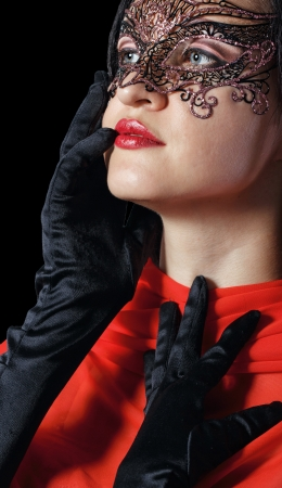 Girl in a Venetian masquerade mask isolated on a black background Stock Photo - 21305198