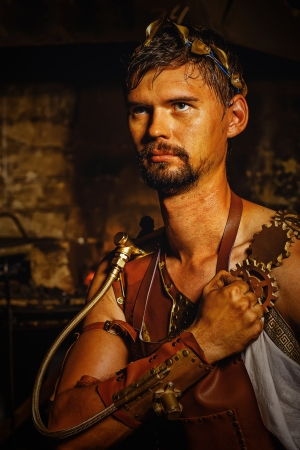 �aucasian: Hephaestus blacksmith in a leather apron, put his right hand to his heart Stock Photo