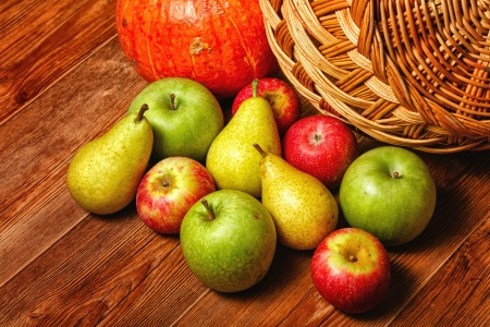 Harvest of ripe fruits and vegetables: apples, pears and pumpkin