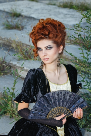 upsweep: Red-haired lady with a ring on his finger and fan