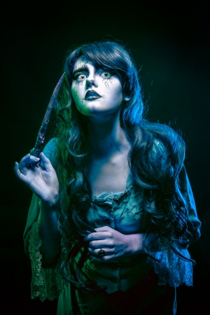 shemale: Girl in the image of a witch with a magic wand shot in studio