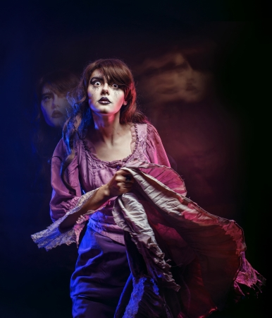 lamia: Girl in the image of a witch with a theatrical make-up in studio shot