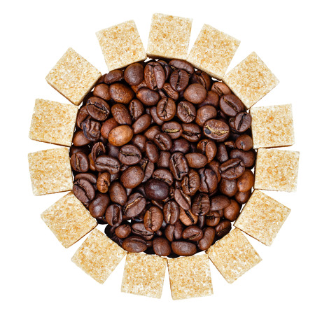 Coffee grains and refined sugar isolated on a white background, shot in studio photo