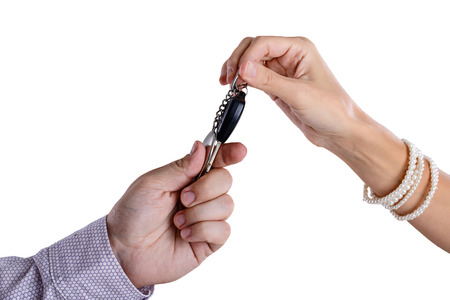 assignation: Transfer from the car ignition keys isolated on  Stock Photo