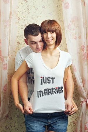 Happy newlyweds hugging T-shirts photo