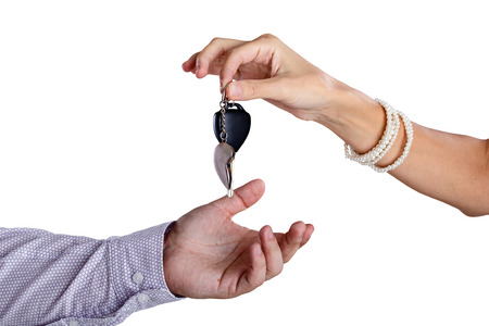assignation: Transfer from the car ignition keys isolated on white background Stock Photo