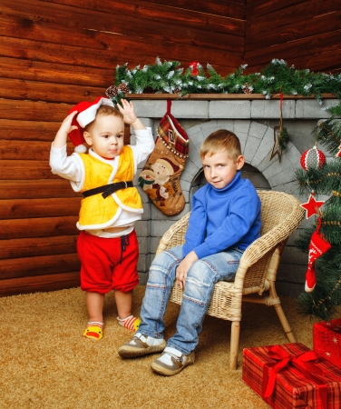 brethren: Two brothers near decorated Christmas tree pending holiday