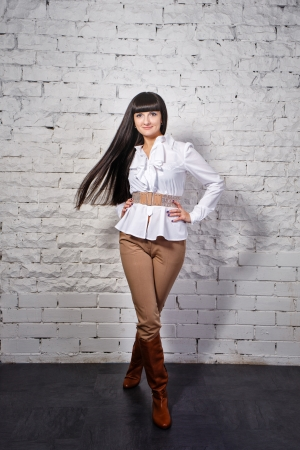 transactional: Attractive young brunette business woman in white blouse