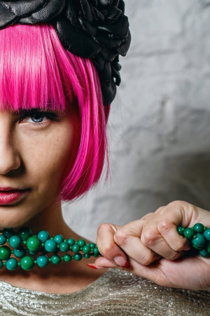 Attractive young girl with rim on head holding beads shot closeup photo