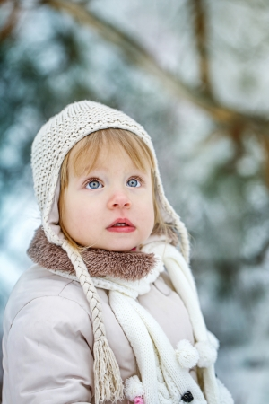 Cute little girl shot close-up on outdoors in winter