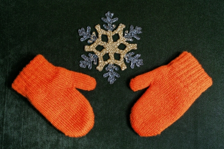 Mittens and snowflake on a textile backing christmas background close up shot photo
