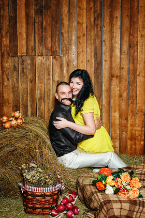 hayloft: Young attractive couple playfully embrace in the hayloft in the village