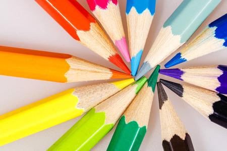 Brightly colored wooden pencils closeup shot