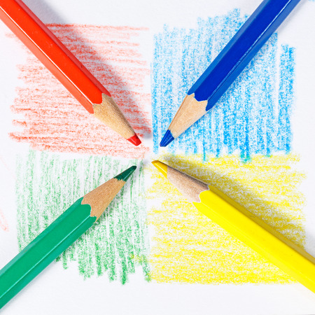 Brightly colored wooden pencils closeup shot background Stock Photo