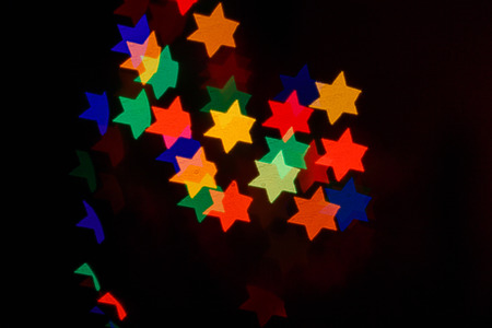 Multicolored bokeh abstract background for the holiday Hanukkah photo