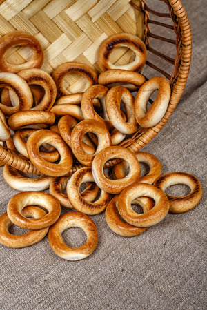 bublik: Russian traditional bagels in a wicker basket close-up shot Stock Photo