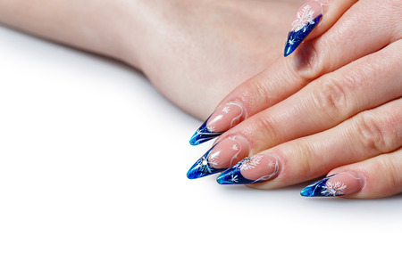 Beautiful manicure on female hand with long and thin fingers shot closeup Stock Photo