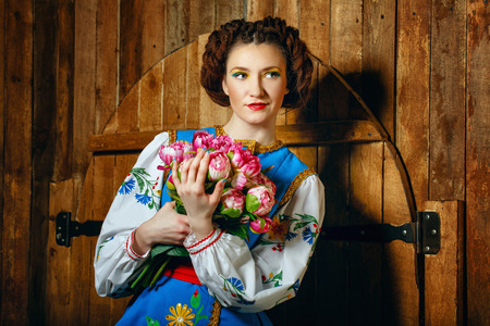 national costume: Girl holding flowers in her hands wearing national costume Stock Photo