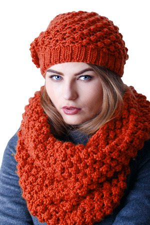 Young attractive Frenchwoman in knitted hat and scarf photo