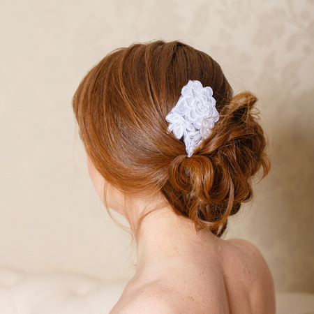 Updo with accessories bride photographed from the back closeup Stock Photo