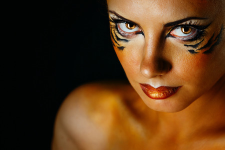 animal sex: Beautiful and dangerous girl tigress with predatory gaze close-up portrait