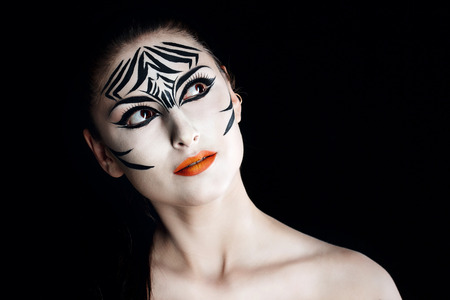 Attractive young girl with make-up of wild zebra close-up portrait photo