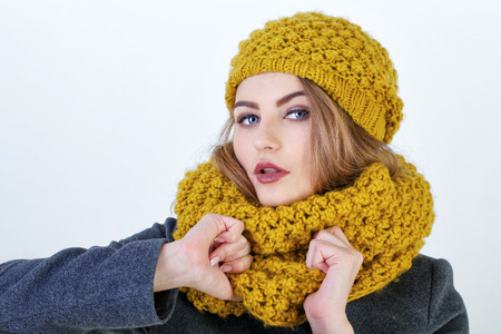 frenchwoman: Young attractive Frenchwoman in knitted hat and scarf isolated