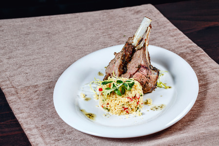 Appetizing grilled lamb chops with a garnish shot closeup photo