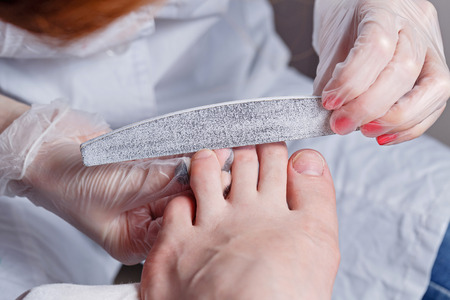The process of creating a pedicure in the spa salon shot closeup