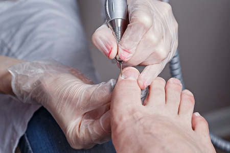 chiropodist: The process of creating a pedicure in the spa salon shot closeup